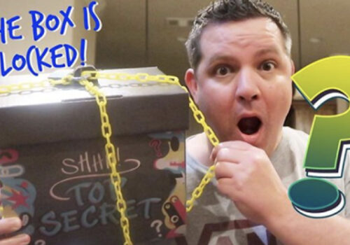 photo graphic of man gasping while holding a box that is locked with a yellow chain